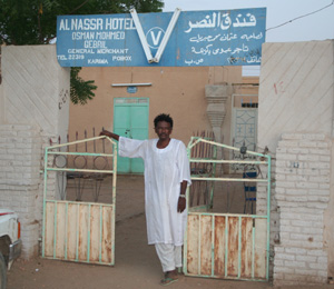 A hotelier in front of his establishment